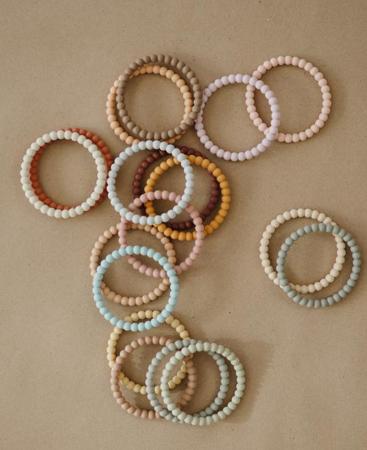 Mushie® Grizalo zapestnica Pearl Linen/Peony/Pale Pink  3 kosi